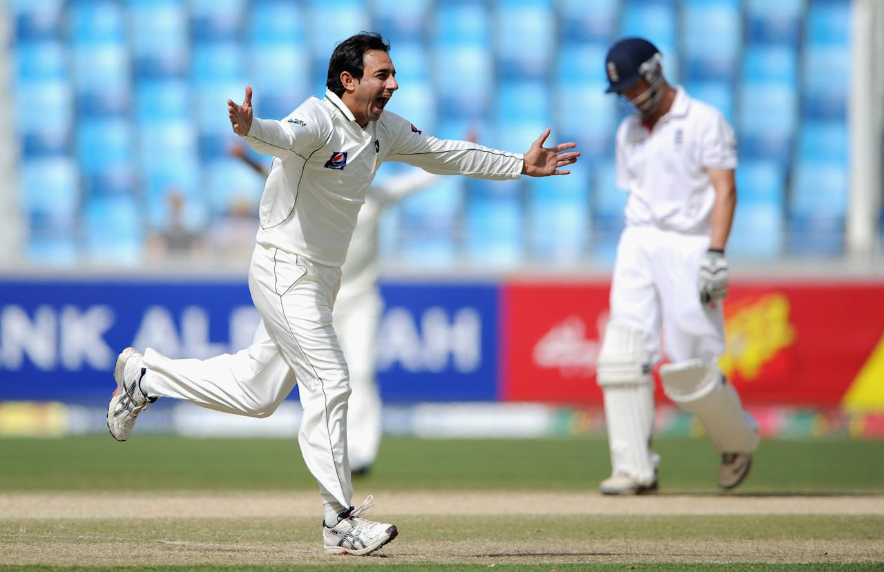 DUBAI, UNITED ARAB EMIRATES - FEBRUARY 06:  Saeed Ajmal of Pakistan celebrates dismissing Jonathan Trott of England during the 3rd Test match between Pakistan and England at The Dubai International Stadium on February 6, 2012 in Dubai, United Arab Emirates.  (Photo by Gareth Copley/Getty Images)