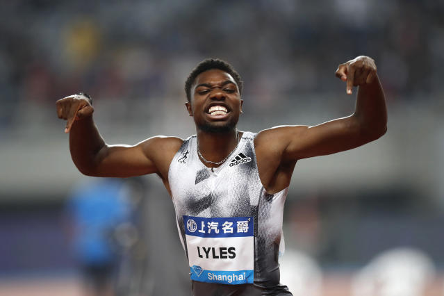 FILE - In this May 18, 2019, file photo, Noah Lyles of the United States reacts after winning the men's 100-meter race during the Diamond League Track and Field meet in Shanghai, China. The most promising signal that track and field remains in good hands even after Usain Bolts retirement comes from a 22-year-old American named Noah Lyles who appreciates the Jamaican superstar more for what he did after his races than during them. When Lyles spends time studying Bolt on video, he looks not at the lanky speedsters form in between the lines, but at the dancing, rollicking post-race celebrations Bolt concocted to make his sport cant-miss viewing whenever he was on the track. (AP Photo/File)
