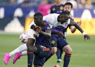 CORRECTS CISSOKO'S TEAM TO SEATTLE SOUNDERS, INSTEAD OF LA GALAXY - LA Galaxy defender Sega Coulibaly, center, collides with Seattle Sounders defender Abdoulaye Cissoko, left, as Sounders midfielder Joao Paulo runs behind during the first half of a Major League Soccer match Saturday, June 19, 2021, in Carson, Calif. (AP Photo/Mark J. Terrill)