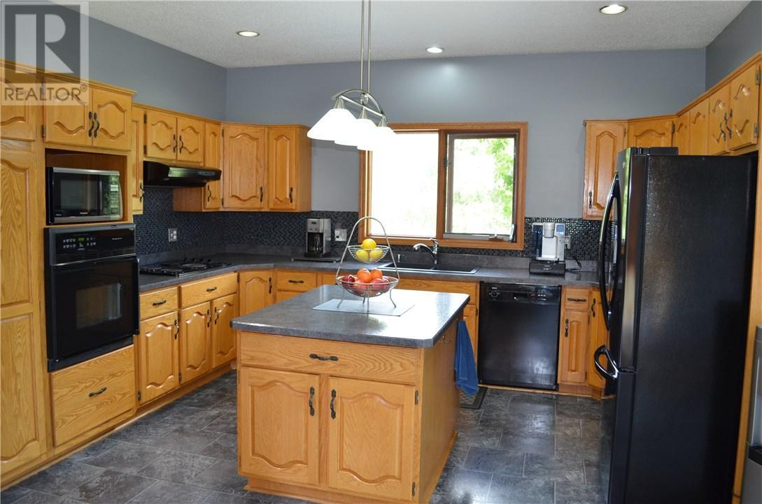 "<p><a rel=""nofollow"">5 Saskatoon Highway 5 East Acreage, Saskatoon, Sask.</a><br /> The U-shaped kitchen has a built-in oven and cooktop, and is part of the open living and dining room area ideal for entertaining.<br /> (Photo: Zoocasa) </p>"