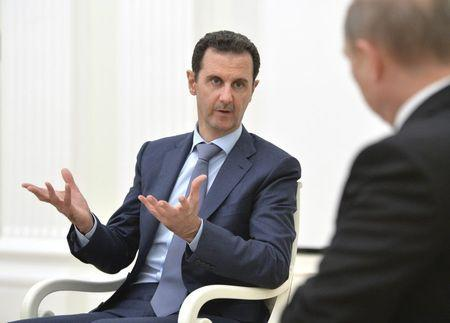 Syrian President Assad speaks during a meeting with Russian President Putin at the Kremlin in Moscow