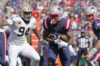 New England Patriots running back James White, center, scrambles past New Orleans Saints defensive end Cameron Jordan (94) during the first half of an NFL football game, Sunday, Sept. 26, 2021, in Foxborough, Mass. (AP Photo/Steven Senne)