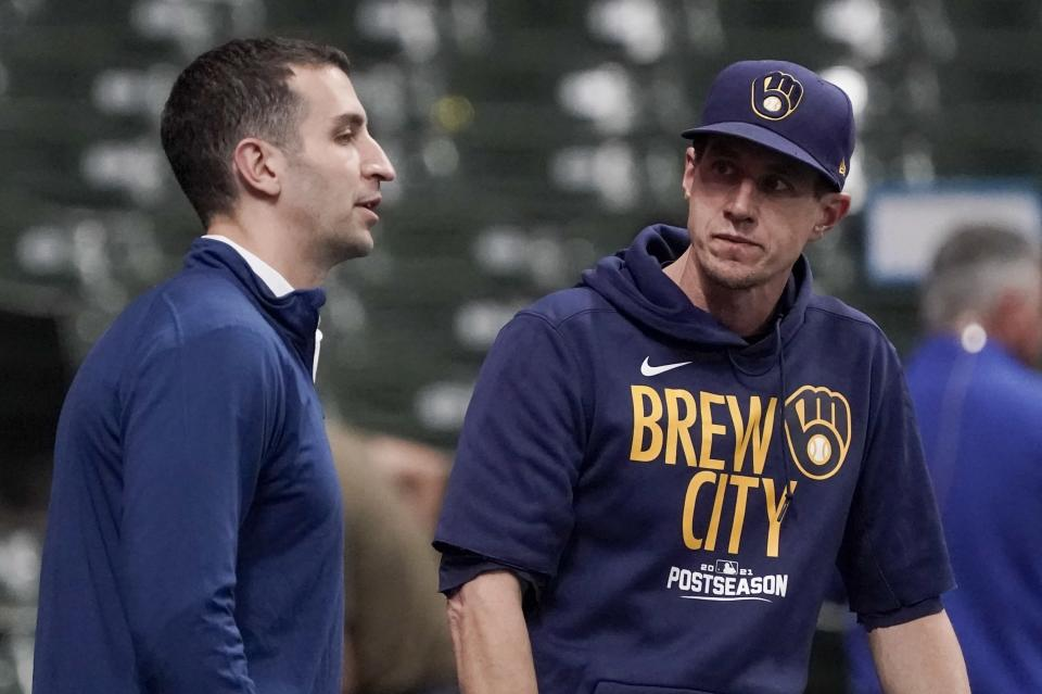 Milwaukee Brewers manager Craig Counsell talks to general manager David Stearns at a practice for the Game 1 of the NLDS baseball game Thursday, Oct. 7, 2021, in Milwaukee. The Brewers plays the Atlanta Braves in Game 1 on Friday, Oct. 8, 2021. (AP Photo/Morry Gash)