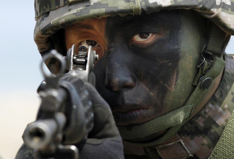 FILE - In this April 26, 2013 file photo, a South Korean Marine takes position during the joint military exercises between South Korea and the United States called Ssangyong 2013 as a part of annual Foal Eagle military exercises in Pohang, south of Seoul, South Korea. North Korea's propaganda machine is churning out near-daily diatribes against the United States and South Korea for a series of soon-to-start military maneuvers, warning nuclear war could be imminent and saying it will take dramatic action of its own if further provoked. (AP Photo/Kin Cheung, FIle)