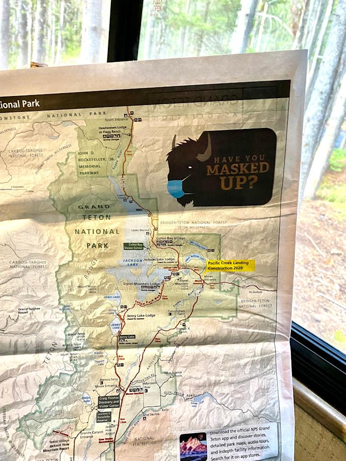 "A graphic on a Grand Teton National Park map for tourists includes a buffalo that asks, ""Have you masked up?"""