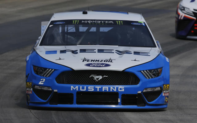 Brad Keselowski (2) drives into Turn 4 during the NASCAR Cup Series auto race at the Martinsville Speedway in Martinsville, Va., Sunday, March 24, 2019. (AP Photo/Steve Helber)