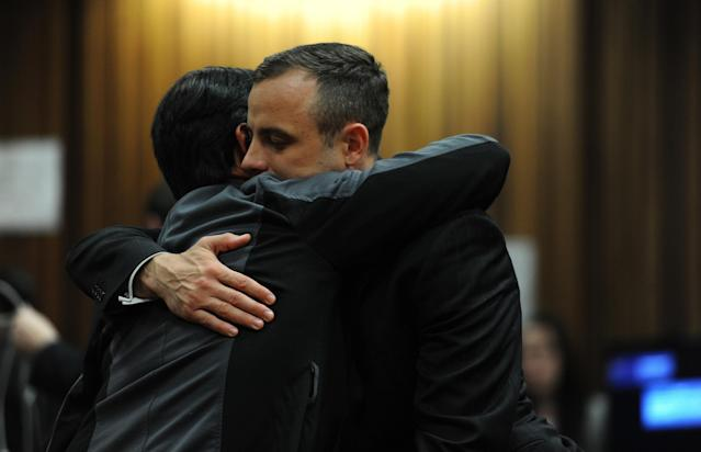 BY COURT ORDER, THIS IMAGE IS FREE TO USE. PRETORIA, SOUTH AFRICA - APRIL 16: Oscar Pistorius hugs a relative in the Pretoria High Court on April 16, 2014, in Pretoria, South Africa. Oscar Pistorius stands accused of the murder of his girlfriend, Reeva Steenkamp, on February 14, 2013. This is Pistorius' official trial, the result of which will determine the paralympian athlete's fate. (Photo by Werner Beukes/SAPA/Gallo Images/Getty Images)