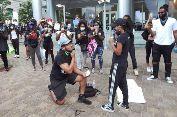 PHOTO: Xavier Young, 26, takes a knee to propose to his girlfriend, Marjorie Alston, 23, during a protest against police brutality and the death of George Floyd, in Raleigh, N.C., on May 30, 2020. (Charles Crouch/@4CVISUALSGROUP)