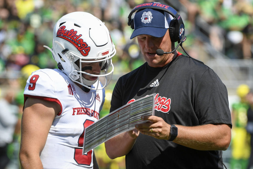 Fresno State quarterback Jake Haener (9) talks with head coach Kalen DeBoer during the third quarter of an NCAA college football game against Oregon, Saturday, Sept. 4, 2021, in Eugene, Ore. (AP Photo/Andy Nelson)