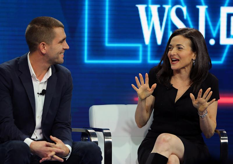 Chris Cox, Chief Product Officer and Sheryl Sandberg, Chief Operating Officer of Facebook speak at the WSJD Live conference in Laguna Beach, California October 25, 2016. REUTERS/Mike Blake
