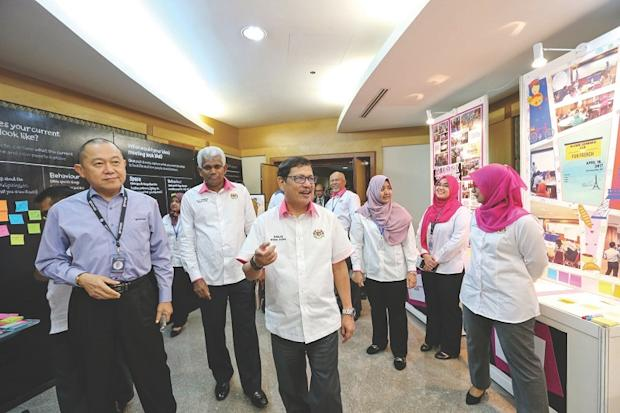 Ramlan and Lee (left) on a walkabout of the Genovasi booth during the Foreign Affairs Ministry Innovation Day event at Wisma Putra, Putrajaya yesterday. — Picture by Ahmad Zamzahuri