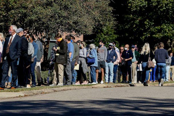 PHOTO: Voters stand in long lines waiting to cast their vote on Nov. 3, 2020, in Auburn, Ala. (Butch Dill/AP, FILE)