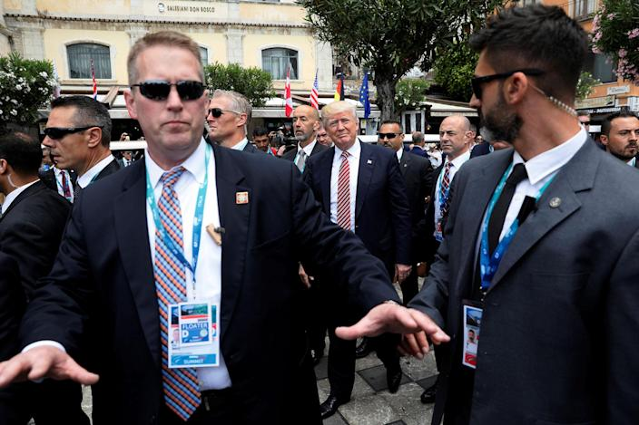 <p>President Donald Trump is surrounded by Secret Service for an event with fellow G7 leaders during their summit in Taormina, Sicily, Italy, May 26, 2017. (Photo: Jonathan Ernst/Reuters) </p>