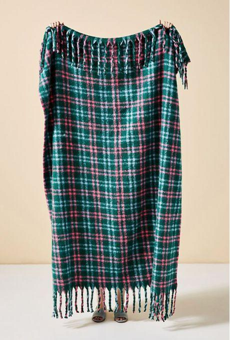 "Christmas is all about excessive coziness, right? Buy it <a href=""https://www.anthropologie.com/shop/tartan-plaid-throw-blanket"" target=""_blank"" rel=""noopener noreferrer"">at Anthropologie</a> for $103."