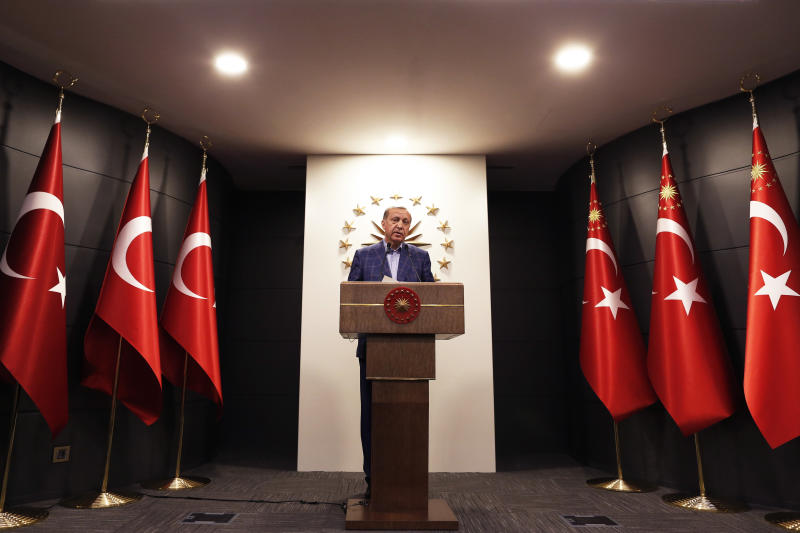 "Turkey's President Recep Tayyip Erdogan makes statements in Istanbul, on Sunday, April 16, 2017. Erdogan declared victory in Sunday's historic referendum that will grant sweeping powers to the presidency, hailing the result as a ""historic decision."" (AP Photo/Lefteris Pitarakis)"