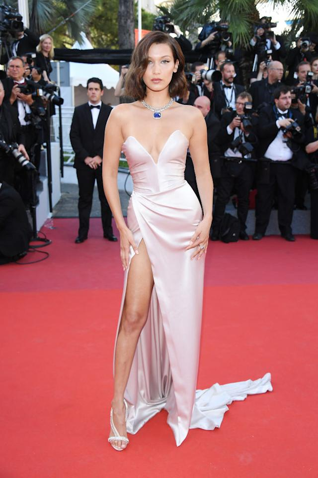 <p>Bella Hadid's red Alexandre Vauthier dress at last year's Cannes Film Festival lit up social media so when deciding what to wear at this year's ceremony, the answer was simple.<br /><br />The model of the moment looked to the same designer for her cold-shoulder gown and donned a similar silhouette as the previous year. Opting for a champagne hue, she donned a thigh-split gown and finished the look with contrasting Bulgari jewels. <em>[Photo: Getty]</em> </p>