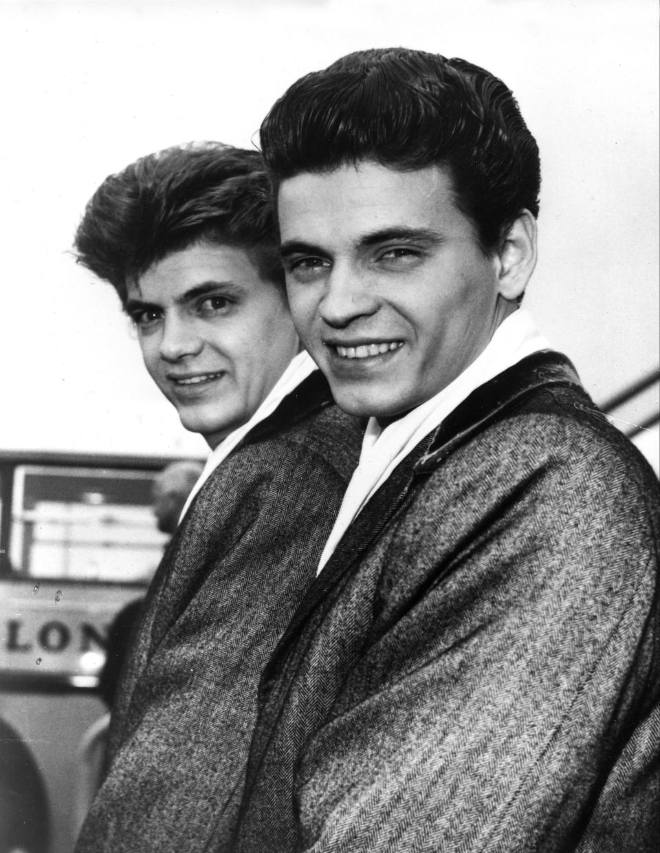 FILE - In this April 1, 1960 file photo, Phil, left, and Don of the Everly Brothers arrive at London Airport from New York to begin their European tour. Don Everly, one-half of the pioneering rock 'n' roll Everly Brothers whose harmonizing country rock hits impacted a generation of rock music, has died. He was 84. A family spokesperson said Everly died at his home in Nashville, Tennessee on Saturday, Aug. 21, 2021. (AP Photo, File)