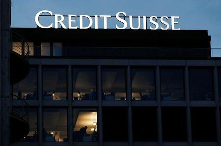 A logo of Credit Suisse is pictured on a building in Geneva