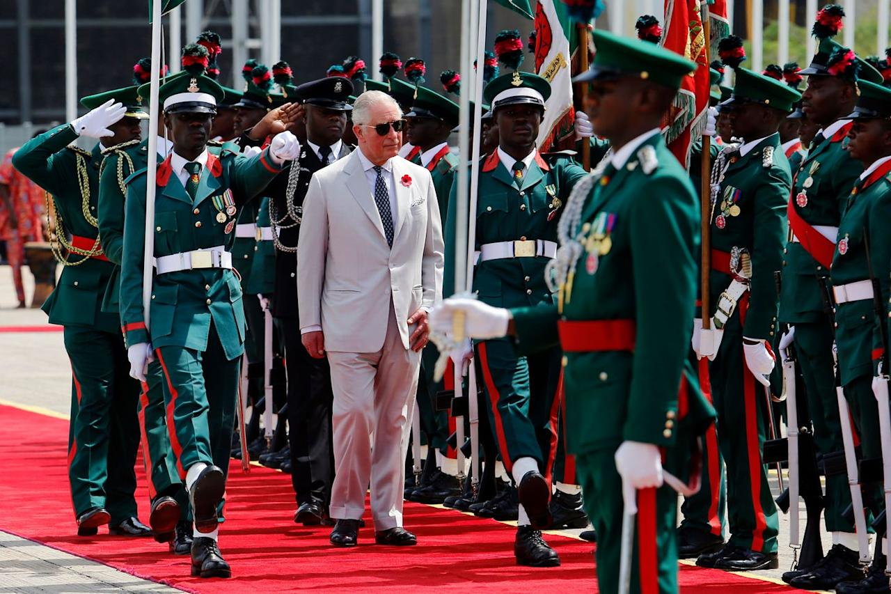<p>Upon his arrival in Nigeria, Prince Charles reviews an honor guard of Nigerian troops at a ceremony. This is the last country Charles and Camila will visit on their eight-day West African tour. </p>