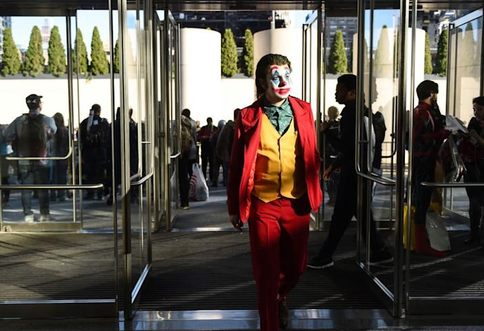 """<div class=""""inline-image__caption""""><p> A cosplayer poses as the Joker during New York Comic Con 2019 on October 05, 2019 in New York City. </p></div> <div class=""""inline-image__credit"""">DANIEL ZUCHNIK/Getty</div>"""
