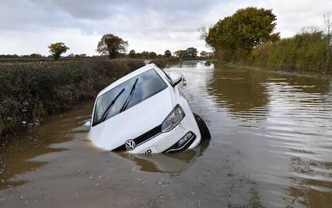 A car sits in flood water in Fishlake - Credit: Anthony Devlin Getty