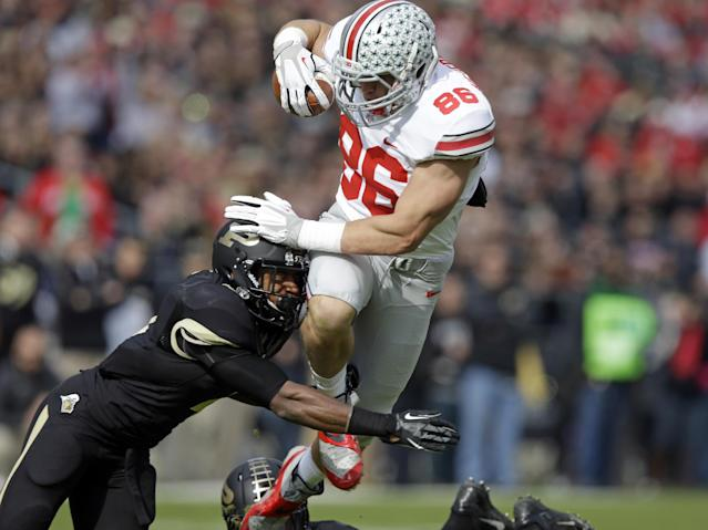 Ohio State tight end Jeff Heuerman, right, is hit by Purdue defensive back Anthony Brown as he tries to leap over a tackle during the first half of an NCAA college football game in West Lafayette, Ind., Saturday, Nov. 2, 2013. (AP Photo/Michael Conroy)