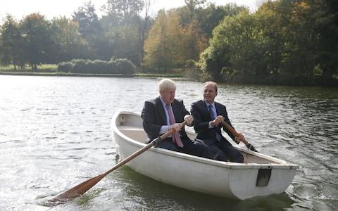 Boris Johnson and the Czech Republic's Deputy Foreign Minister Ivo Sramek in a row boat in the grounds of Chevening House - Credit: Daniel Leal-Olivas/AFP