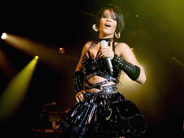 Rihanna performs onstage wearing black leather outfit in 2007