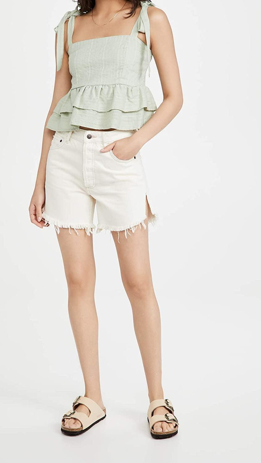 <p>The modern look and feminine silhouette of this <span>Lost + Wander Springtime Ruffle Top</span> ($78) make it a must-have.</p>
