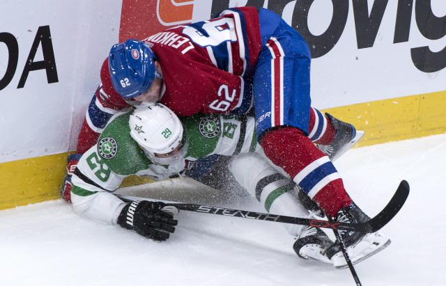 Dallas Stars defenseman Greg Pateryn (29) is dumped by Montreal Canadiens left wing Artturi Lehkonen (62) during the first period of an NHL hockey game, Tuesday, March 13, 2018, in Montreal. (Paul Chiasson/The Canadian Press via AP)