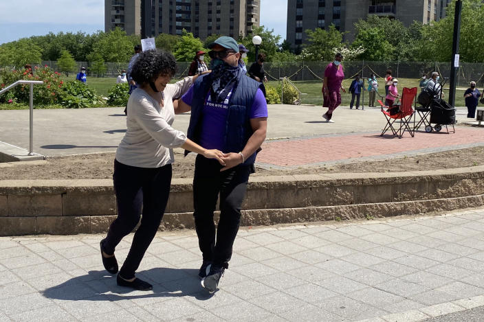 Image: NYC mayoral candidate Dianne Morales dances with a local resident in the Bronx, N.Y. (Nicole Acevedo / NBC News)
