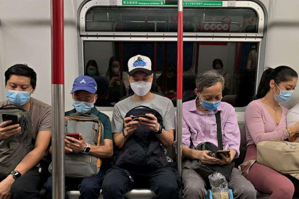 PHOTO: Passengers wear surgical masks in an MTR train in Hong Kong, July 13, 2020. (Tyrone Siu/Reuters)
