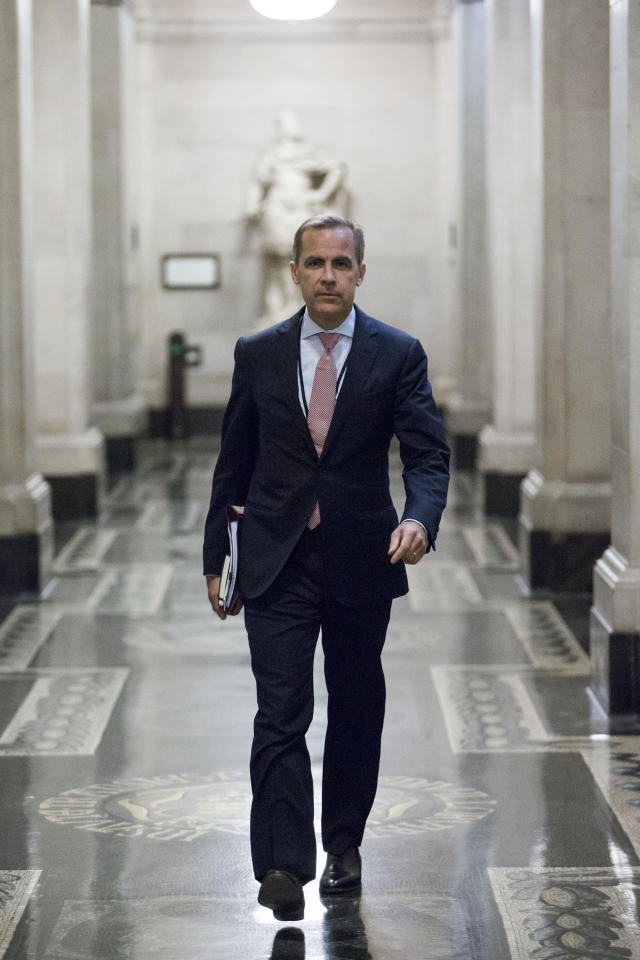 Mark Carney, governor of the Bank of England, walks to a monetary policy committee (MPC) briefing on his first day inside the central bank's headquarters in London.