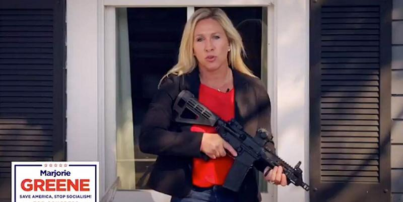 """Republican congressional candidate Marjorie Taylor Greene brandishes an AR-15 while defending property against nonexistent """"antifa"""" activists in a promotional video."""