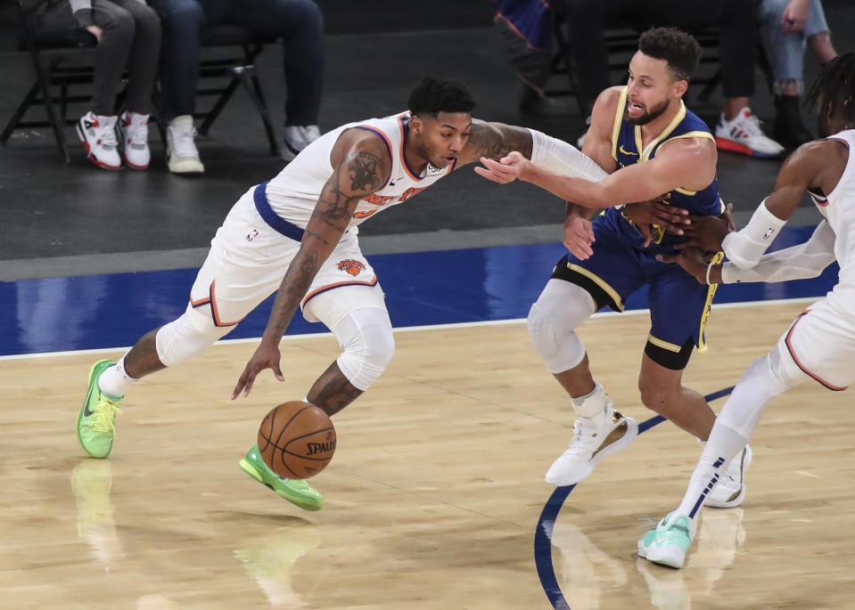 New York Knicks guard Elfrid Payton (6) moves past Golden State Warriors guard Stephen Curry during the second quarter of an NBA basketball game Tuesday, Feb. 23, 2021, in New York. (Wendell Cruz/Pool Photo via AP)