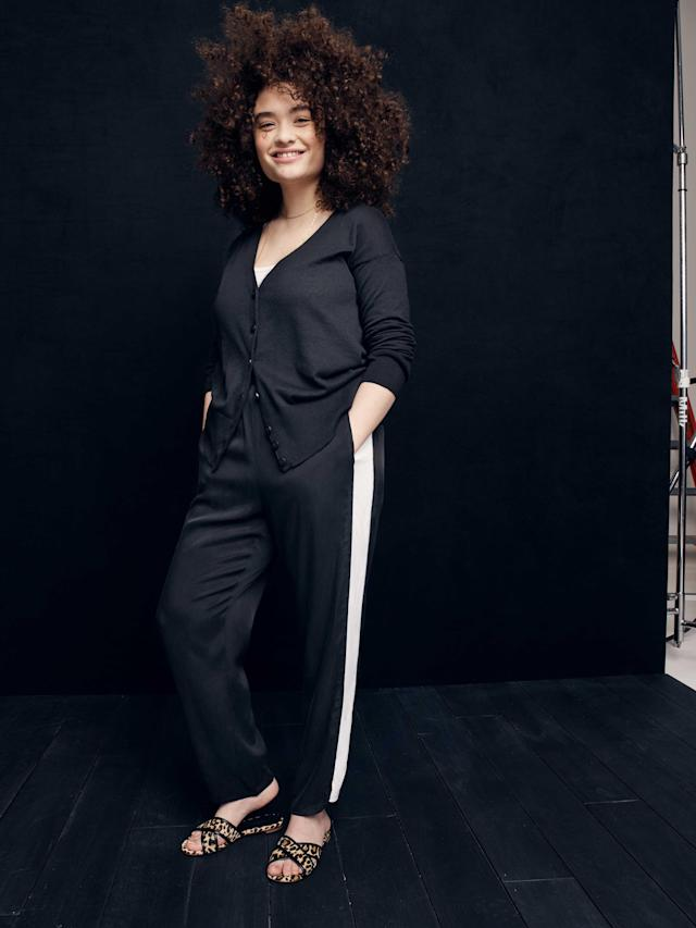 Model wears a black cardigan and racer stripe trouser from the new, size-inclusive J.Crew collection with Universal Standard. (Photo: Courtesy of J.Crew)