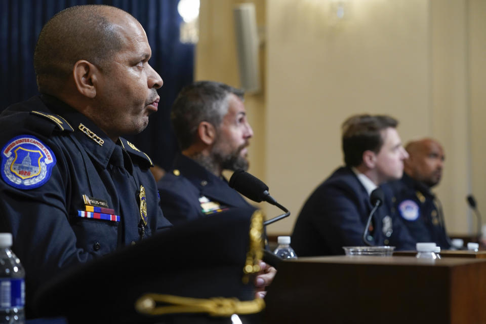 From left, U.S. Capitol Police Sgt. Aquilino Gonell, Washington Metropolitan Police Department officer Michael Fanone, Washington Metropolitan Police Department officer Daniel Hodges and U.S. Capitol Police Sgt. Harry Dunn watch a video of the rioters during the House select committee hearing on the Jan. 6 attack on Capitol Hill in Washington, Tuesday, July 27, 2021. (AP Photo/ Andrew Harnik, Pool)