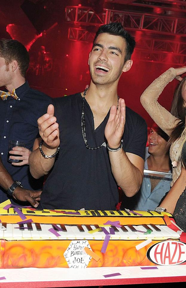 """Heartthrob Joe Jonas celebrated his 22nd birthday in Sin City by lounging at Aria's Liquid Pool, gambling at Deuce Lounge, and performing tunes from his new solo album, <i>FastLife</i>, at Haze nightclub last Saturday. <a href=""""http://www.eonline.com/news/hwood_party_girl/happy_birthday_joe_jonas_heres_how/258047"""">E! Online</a> reported the JoBro was surrounded by girls at his VIP table. Denise Truscello/<a href=""""http://www.wireimage.com"""" target=""""new"""">WireImage.com</a> - August 13, 2011"""