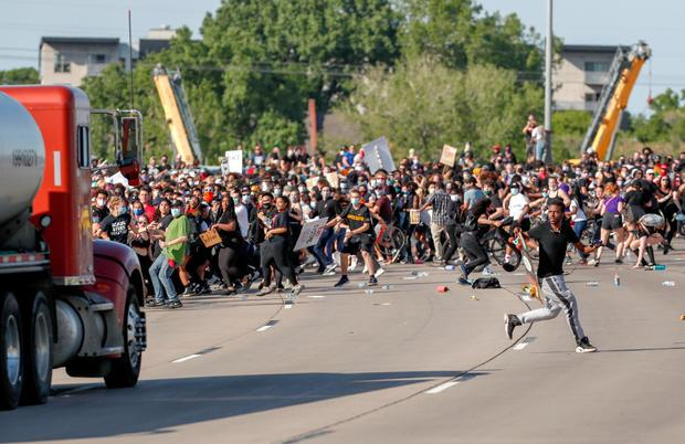 Tanker truck drives into protesters on bridge