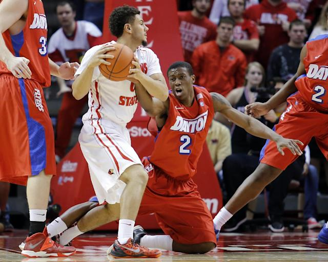 Dayton guard Jordan Sibert (24) reaches for the ball against Illinois State guard Kaza Keane (0) during the first half of an NCAA college basketball game at Redbird Arena Saturday, Dec. 7, 2013, in Normal, Ill. (AP Photo/ Stephen Haas)
