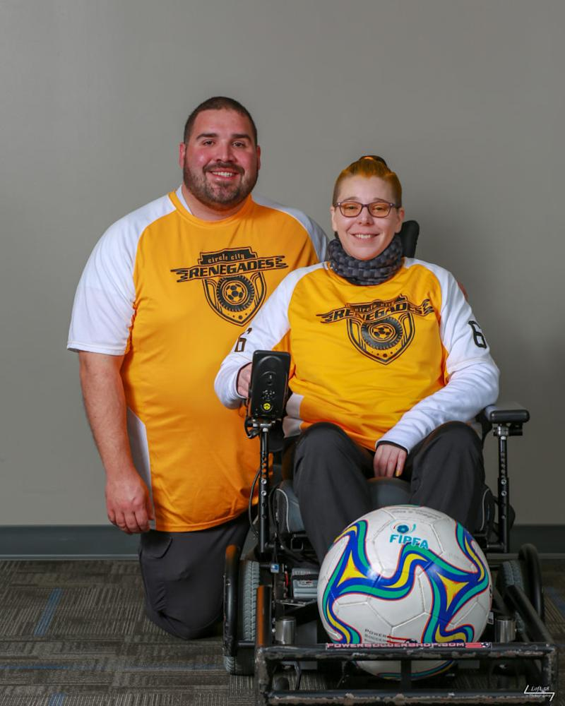 My husband and I in our Power Soccer Team jerseys. Me as a player, my husband as coach.
