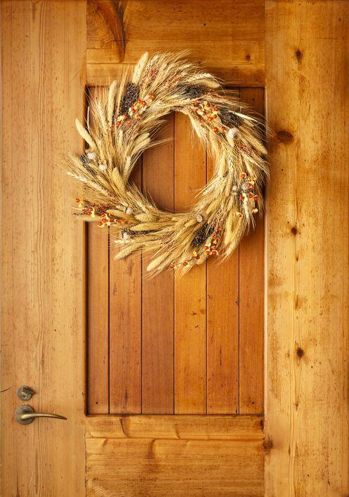 <p>A rustic wreath made of wheat stalks is handsome left plain or slightly elevated with acorns and sprays of yellow and orange berries. </p>