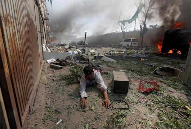 <p>A wounded man lies on the ground at the site of a blast in Kabul, Afghanistan May 31, 2017. (Omar Sobhani/Reuters) </p>