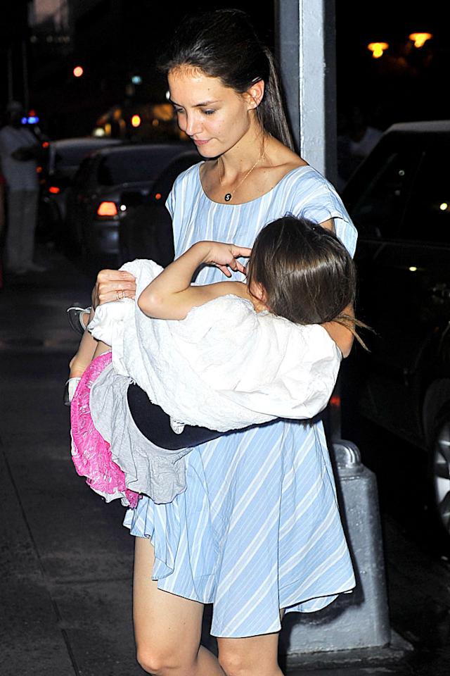 """By nightfall, Tom Cruise's daughter was exhausted! She insisted her famous mommy carry her inside their Big Apple apartment. (6/21/2012)<div style=""""display:none;"""" class=""""skype_pnh_menu_container""""><div class=""""skype_pnh_menu_click2call""""><a class=""""skype_pnh_menu_click2call_action"""">Call</a></div><div class=""""skype_pnh_menu_click2sms""""><a class=""""skype_pnh_menu_click2sms_action"""">Send SMS</a></div><div class=""""skype_pnh_menu_add2skype""""><a class=""""skype_pnh_menu_add2skype_text"""">Add to Skype</a></div><div class=""""skype_pnh_menu_toll_info""""><span class=""""skype_pnh_menu_toll_callcredit"""">You'll need Skype Credit</span><span class=""""skype_pnh_menu_toll_free"""">Free via Skype</span></div></div>"""