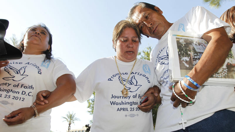 Members of Promise Arizona, Leonila Martinez, left, Patricia Rosas, and Gustavo Cruz, right, react to the United States Supreme Court decision regarding Arizona's controversial immigration law, SB1070, as the ruling comes down at the Arizona Capitol Monday, June 25, 2012, in Phoenix. The Supreme Court struck down key provisions of Arizona's crackdown on immigrants Monday but said a much-debated portion on checking suspects' status could go forward.Monday, June 25, 2012, in Phoenix.(AP Photo/Ross D. Franklin)