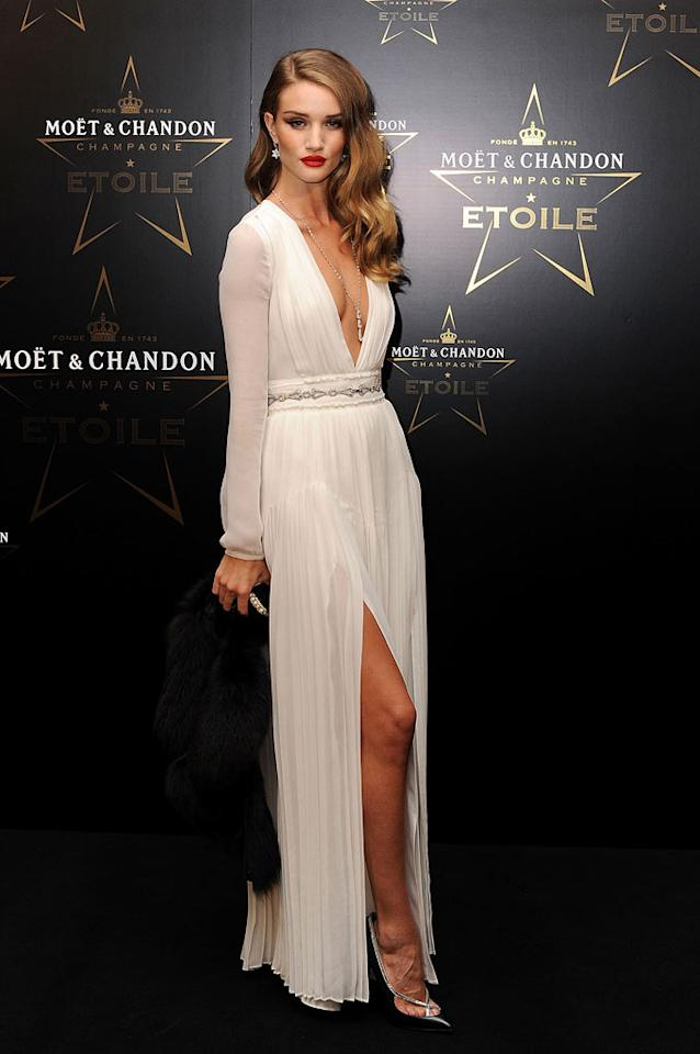 """""""Transformers: Dark of the Moon"""" star Rosie Huntington-Whiteley put her best foot forward at the Moet & Chandon Etoile Awards in a glamorous white chiffon gown, courtesy of Burberry. Wavy tresses, Chopard jewels, and Louboutin heels completed her knockout look. Ben Pruchnie/<a href=""""http://www.gettyimages.com/"""" target=""""new"""">GettyImages.com</a> - September 19, 2011"""