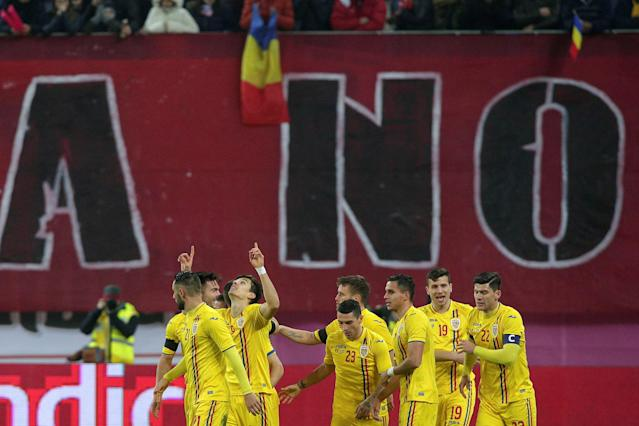 Soccer Football - International Friendly - Romania vs Sweden - National Arena, Craiova, Romania - March 27, 2018 Romania's Dorian Rotariu celebrates scoring their first goal with team mates Inquam Photos/Octav Ganea via REUTERS ROMANIA OUT. NO COMMERCIAL OR EDITORIAL SALES IN ROMANIA THIS IMAGE HAS BEEN SUPPLIED BY A THIRD PARTY. IT IS DISTRIBUTED, EXACTLY AS RECEIVED BY REUTERS, AS A SERVICE TO CLIENTS
