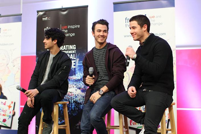 MINNEAPOLIS, MN - FEBRUARY 06: (L-R) Joe Jonas, Kevin Jonas and Nick Jonas of the musical trio the Jonas Brothers surprise 600 students at Minneapolis Patrick Henry High School to launch 'We Day' on February 6, 2013 in Minneapolis, Minnesota. (Photo by Adam Bettcher/Getty Images for Free The Children)