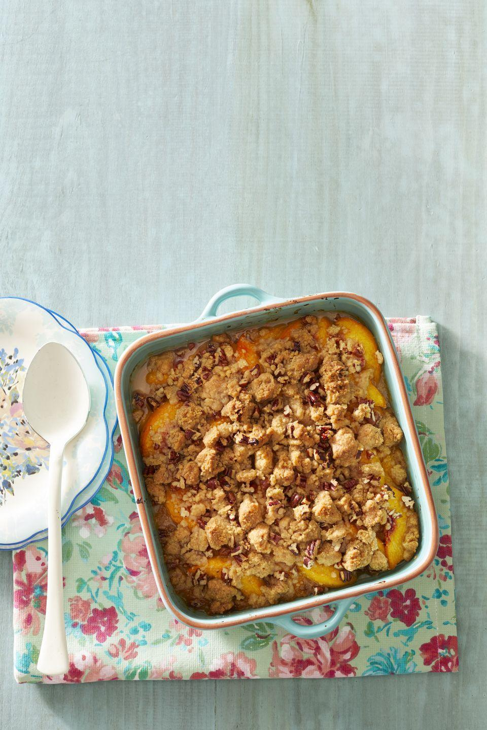 """<p>Peaches and pecans are a match made in heaven, and the proof is in this easy crisp. Don't forget the ice cream!</p><p><strong><a href=""""https://www.thepioneerwoman.com/food-cooking/recipes/a32097453/peach-pecan-crisp-recipe/#"""" rel=""""nofollow noopener"""" target=""""_blank"""" data-ylk=""""slk:Get Ree's recipe."""" class=""""link rapid-noclick-resp"""">Get Ree's recipe.</a><br></strong></p><p><a class=""""link rapid-noclick-resp"""" href=""""https://go.redirectingat.com?id=74968X1596630&url=https%3A%2F%2Fwww.walmart.com%2Fsearch%2F%3Fquery%3Dpioneer%2Bwoman%2Bbaking%2Bpan&sref=https%3A%2F%2Fwww.thepioneerwoman.com%2Ffood-cooking%2Frecipes%2Fg36382592%2Fpeach-desserts%2F"""" rel=""""nofollow noopener"""" target=""""_blank"""" data-ylk=""""slk:SHOP BAKING PANS"""">SHOP BAKING PANS</a></p>"""