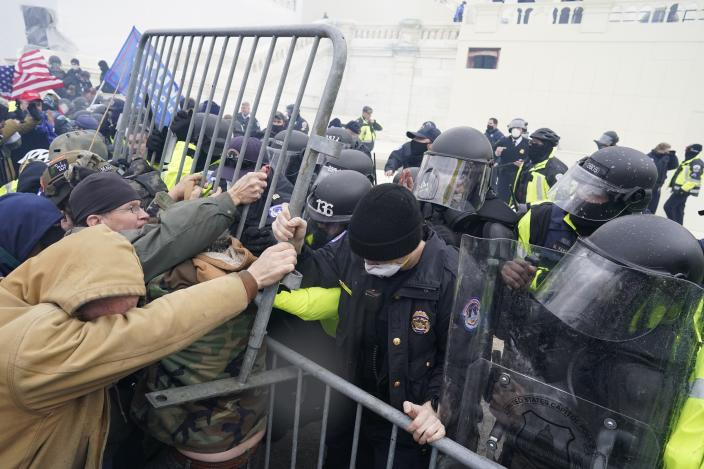 WASHINGTON, DC - JANUARY 06:  Police try to hold back protesters who  gather storm the Capitol and halt a joint session of the 117th Congress on Wednesday, Jan. 6, 2021 in Washington, DC. (Kent Nishimura / Los Angeles Times via Getty Images)